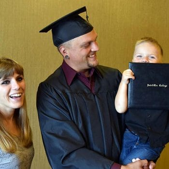 IntelliTec graduate celebrates his achievement with family.
