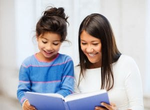 Family, children, education, school and happy people concept - mother and daughter with book