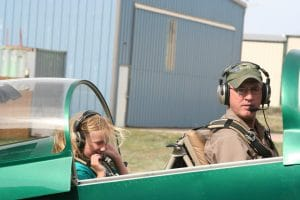 Brad enjoys his favorite downtime passion, flying his two-seater airplane. Pictured with Loren Schowengerdt.