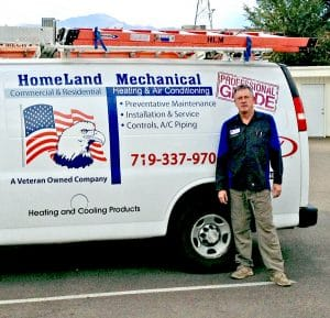 Newly hired Refrigeration and HVAC Technician college graduate Brad Henry on-the-job with HomeLand Mechanical in Colorado Springs.