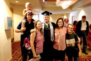 Brad Henry - HVAC and Refrigeration Technician program graduate of IntelliTec College in Colorado Springs - pictured with son-in-law Ryan Slusher, grandsons, daughter Stephanie, and wife Denise.