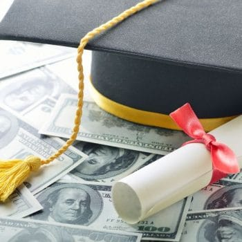 Graduation hat with diploma and money