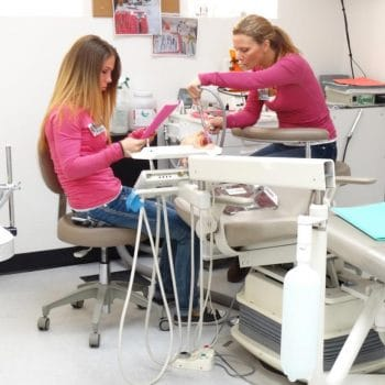 Dental Assistant students work together to complete their lab assignments in Grand Junction.