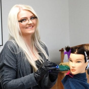 Cosmetology students practice hair and make-up services on student kit mannequins.
