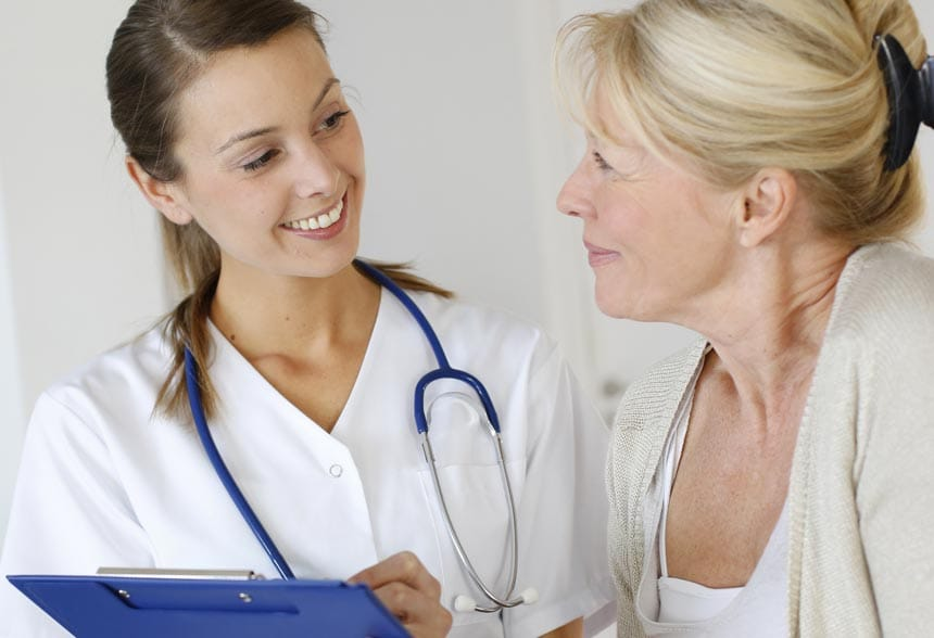 Medical assistant consulting with a patient.