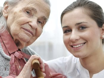 Senior woman with her nursing assistant caregiver at home