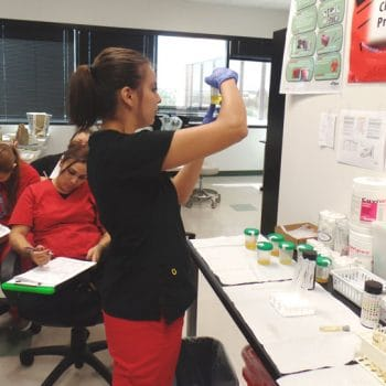 Medical Assistant students learn how to perform tests during lab time.
