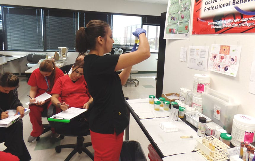 Medical Assistant Students Learn How To Perform Tests During Lab Time