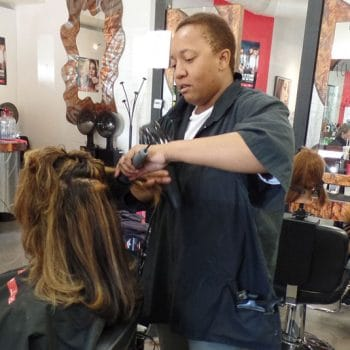 IntelliTec College of Pueblo's Cosmetology students work on clients in the salon.